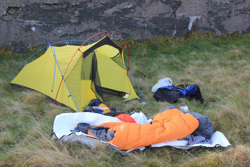 Packing away the tent below the dam wall