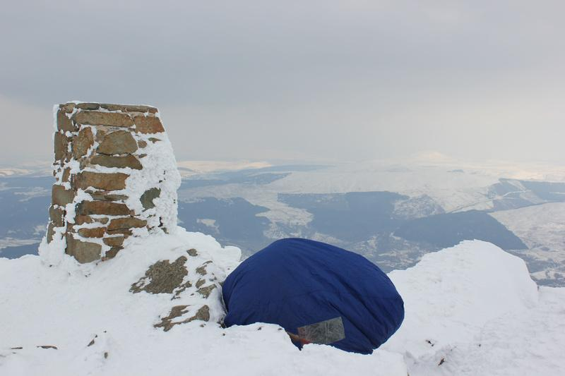 Sheltering in a bothy bag on the summit